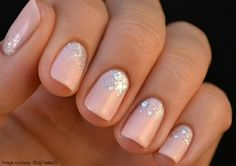 This reverse French-esque mani with glitter is feminine and fun for the winter