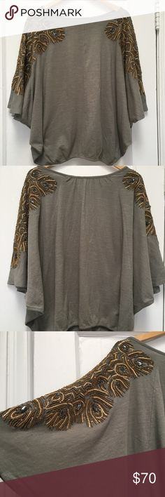 Anthropologie feather cloaked top NWT M/L So chic! Brand new Vanessa Virginia top from Anthropologie. Truly spectacular beading on the sleeves. Anthropologie Tops Blouses