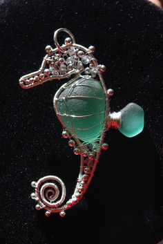 Teal seahorse wire wrapped seaglass pendant. SOLD.   Flickr