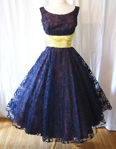 Navy blue and Lace  I LOVE this dress as a brides maid dress for the other brides maids with out the yellow waist band i want it white