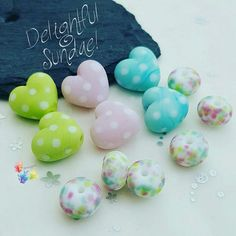 Lampwork Glass Beads Delightful Sundae 50's Diner Range Delightful Sundae! Cute little beads in a 50's pastel diner theme. Polka dot hearts in pastel shades if green, pink and blue with coordinating spacers. Made with premium glass, they have been etched for a softer look. Choose to buy either the full set (hearts & spacers), set of 6 hearts (2 in each colour) or just a single pair of hearts! Your beads your way! #glitteringprizeglass #polkadots #retro #50'sdiner #hearts #pastel #lampwork