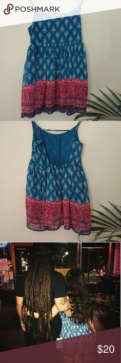 Boho babydoll dress Beautiful flowy boho dress with an open back. Perfect for casual days or concerts. In great condition. Brand: Full Tilt Tilly's Dresses Backless