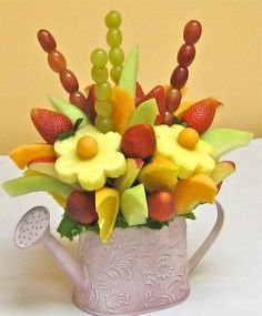 Hermoso arreglo de frutas                                                                                                                                                                                 Mais