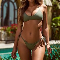 An olive push up bikini on tanned skin, it doesn't get any sexier. Check out our huge range of push up bikini sets, available on various sizes and colors. Shop now. Push Up Bikini, Bikini Sexy, Mädchen In Bikinis, Bikini Swimwear, String Bikinis, Bikini Verde, Green Bikini Set, Cute Bathing Suits, Women Swimsuits