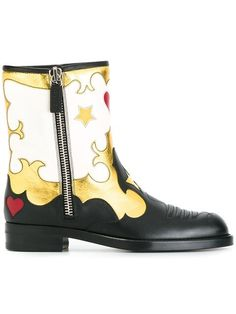 Shop Gucci star printed zipped boots.