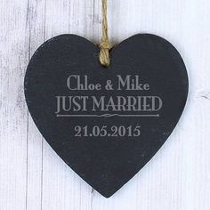 Just Married Slate Heart DecorationPLEASE NOTE: Please double check your personalisation as how it appears here will be how it appears on the product, including spacing and punctuation. Please do not include accents and special symbols as some of our processes will not allow this. This includes accents above and below the alphabetical or numerical text.Personalise this slate hanging heart for a newly married couple with 2 names including an '&' or a surname using up to 20 characters and ...
