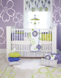 Flower decal nursery love the white tropical flowers painted onto the purple wall