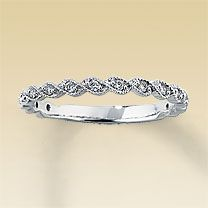 I really like this band, and I think it would go well with my engagement ring :)