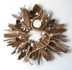 Hand crafted driftwood wreath with sea glass, barnacles, natural sea shells and sand dollars found along the coast of Maine.