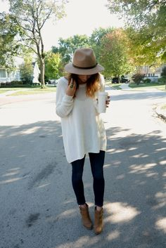 brown panama hat. oversized sweater. black skinny jeans. brown ankle boots.