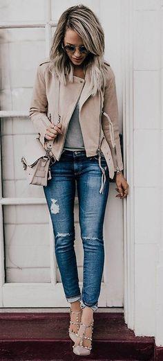 Beige leather moto jacket, shoulder bag & rock stud shoes, grey top, skinny jeans