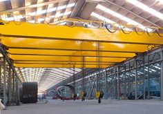 Top running double girder overhead hook crane: http://overheadcranemanufacturers.com/top-running-overhead-crane/.