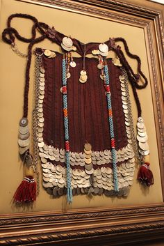 A lovely Bedouin veil from Sinai, Egypt.  With antique Ottoman silver coins, glass beads, amber, and embroidery.