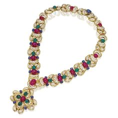 GIOVANE, ITALY Set with cabochon rubies weighing 54.91 carats, cabochon emeralds weighing 20.11 carats, and cabochon sapphires weighing 17.22 carats, accented by round diamonds weighing 28.95 carats