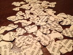 Vintage Book Page Confetti!  Perfect for Around the Centerpieces @ the reception! (....i have MANY an old book for this, Just need heart hole punch)
