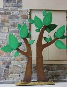 This playful paper mache and foam tree doubles as an easel.   www.give-em-props-studio.com