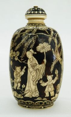 Fine Chinese Colored & Carved Ivory Snuff Bottle with Dynasty Marks