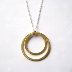 Circle Necklace, Brass Circle Sterling Silver Chain Necklace. $27.00, via Etsy.