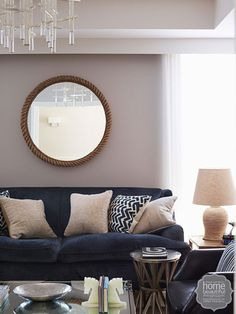 Nature study: the sitting room has a more formal feel but it's still an everyday space. A symmetrical layout lends the room its classic look, while the overstuffed midnight-blue couch acts as a focal point.