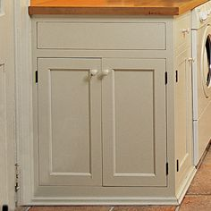 custom cabinets in combination mud room and laundry room (like the no toe- kick look)