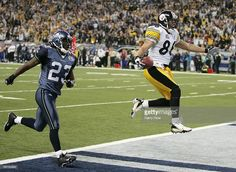 Wide receiver Hines Ward #86 of the Pittsburgh Steelers scores a touchdown on a pass from receiver Antwaan Randle El #82 in front of cornerback Marcus Trufant #23 of the Seattle Seahawks in the fouth quarter of Super Bowl XL at Ford Field on February 5, 2006 in Detroit, Michigan.