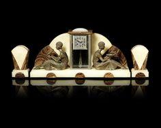 Demetre Chiparus (1886-1947) An Art Deco Metal and Marble Figural Clock Garniture, circa 1925