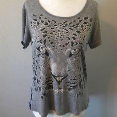 Cheetah tee Super cute tee has sheer Aztec print fabric on back. Subtle hi-low hem. Front is 96% rayon 4% spandex. Back is 100% polyester. Sugar High Tops Tees - Short Sleeve