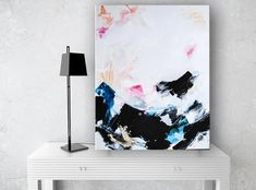 Large contemporary painting featuring blues, pale pinks, tan, black, gold and white. Vertical for an entryway or accent wall!