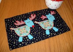 Turquoise Reindeer Mugrug ~ The Patchsmith. Not big on the turquoise but I like the pattern.