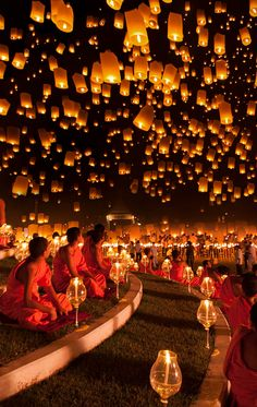 Floating lantern festival in Chiang Mai, Thailand. Released wish lanterns are symbolic of letting problems or worries float away.