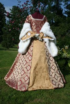 """catherine parr tudor gown...Catherine Parr Tudor gown with faux fur sleeves, in your choice of color combinations  damask or brocade back-laced bodice with faux pearl embellishments at the neckline and undersleeves. Oversleeves will be made of (color of your choice) faux fur. Back laces through grommets, undersleeves have """"cheater"""" cuffs; Overskirt of brocade, draw cord underskirt forepart of brocade"""