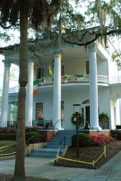 A Greek revival house with elegant Corinthian columns in Ardsley Park - Savannah, GA