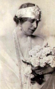 Mare also augmented the Cartier pearl tiara by wearing a scarf under the bandeau and attaching a large pearl and diamond brooch just below it, as well as ropes of pearls round her neck, and another one under her chin. Royal Tiaras, Royal Jewels, Crown Jewels, Royal Crowns, Vintage Couples, Chic Vintage Brides, Vintage Weddings, Royal Family Lineage, Romanian Royal Family