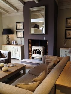 10 AMAZING Purple Rooms This is pretty nice. I'm looking for a place to put a gas log stove (so I won't freeze if the electric goes out for days) and the living room fireplace would look great this way. Living Room With Fireplace, New Living Room, My New Room, Home And Living, Log Burner Living Room, Ivory Living Room, Living Spaces, Salons Violet, Feature Wall Living Room