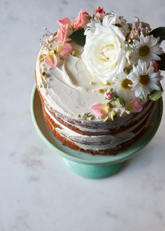 """When does something transition from merely a trend to a prominent style?  Because let's face it, Naked Cakes are here to stay. And I'm not  complaining one bit about it!  I've definitely played around with my fair share of """"naked"""" cake designs  over the past few years - going from completely """"stark naked"""" to more of a  sheer crumb coat and topped with either sugary drips, sprinkles, and candy  to more rustic, natural adornments. Sure you can slather on some frosting  between layers of…"""