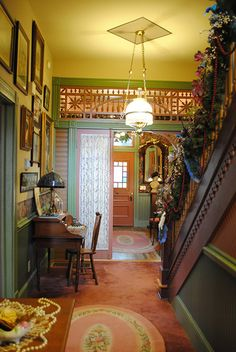 "The center hall of our Folk Victorian. It did not originally have an upstairs. My husband designed and built it ""good as old."""