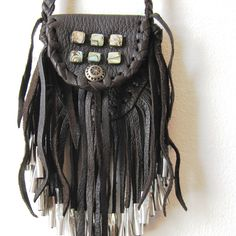 This is a black medicine bag created by Nathalie Waldman of the Dene tribe. The bag is named Datsą́ which is the Dene word for Raven. Medicine bags are used for carrying plants that hold medicinal powers. Although they may not hold the same purpose for the person that purchases them, it is still important to know the origin (which it explains on the website)