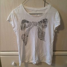 "Selling this ""Aeropostale Bling T Shirt"" in my Poshmark closet! My username is: 16tferr. #shopmycloset #poshmark #fashion #shopping #style #forsale #Aeropostale #Tops"
