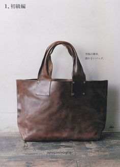 Purse inspiration...Leather bag. I love the handles on this tote