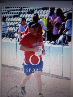 Jason finishing his first half marathon at the Cal Classic 2014
