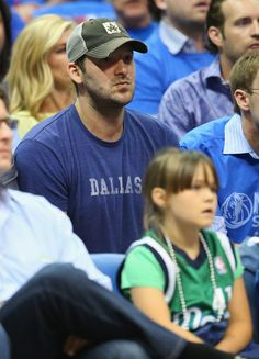 Tony Romo Photos Photos - Tony Romo of the Dallas Cowboys watches a game between the San Antonio Spurs and the Dallas Mavericks in Game Four of the Western Conference Quarterfinals during the 2014 NBA Playoffs at American Airlines Center on April 28, 2014 in Dallas, Texas. NOTE TO USER: User expressly acknowledges and agrees that, by downloading and or using this photograph, User is consenting to the terms and conditions of the Getty Images License Agreement. - San Antonio Spurs v Dallas…