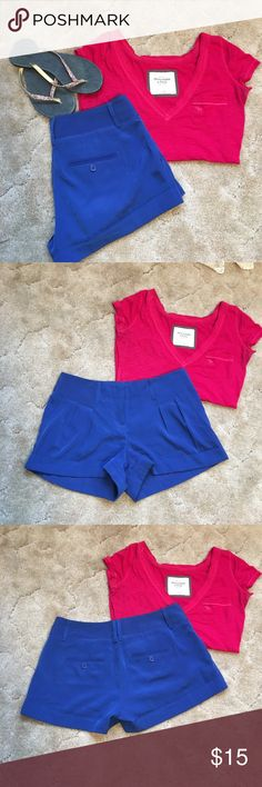 Express silky smooth shorts Beautiful blue shorts by Express. Features front pleats, front side pockets, back buttoned down pockets, and rolled cuffs. 100% polyester. Size 2. Express Shorts