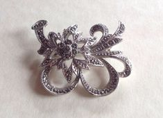 A personal favourite from my Etsy shop https://www.etsy.com/uk/listing/150157119/vintage-marcasite-pretty-floral-spray