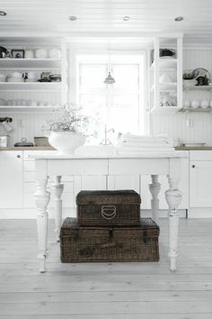 Beautiful contrast in color and texture of a white painted table with natural baskets.