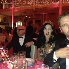 Katy Perry wants to scratch her cheek, but does not to ruin her makeup.  Celebrity Candid & Behind-the-Scenes Pictures Met Gala 2013
