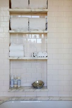 A recessed tile shelf with marble ledges will make any bathroom memorable. Spotted on Decorpad | Apartment Therapy