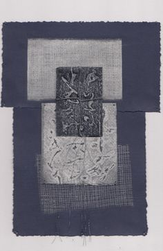 Silver prints on indigo paper with silver thread by Ann Symes