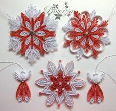 Quilled snowflakes by pinterzsu