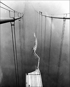 The Tacoma Narrows Bridge is inspected after it collapsed in November, 1940.