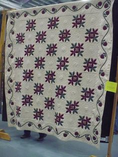 I love how simple this quilt appears. It's understated and the details really pop. Plus I love the purple and green on white look!